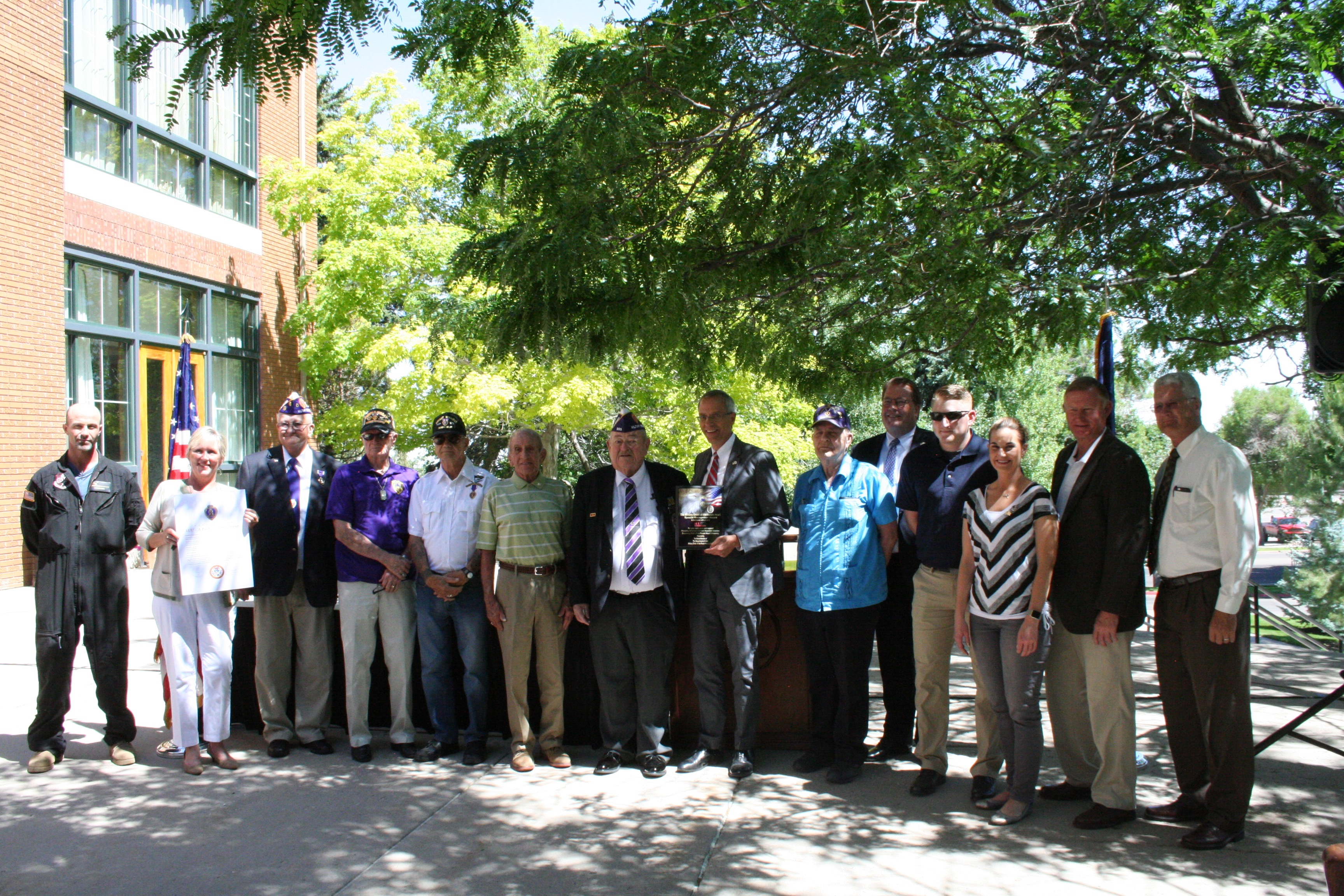 Purple Heart Recipients, SUU Administration and local elected officials join for a photo with the official proclamation, Cedar City, Utah, June 24, 2016 | Photo by Kaleigh Bronson, St. George News / Cedar City News