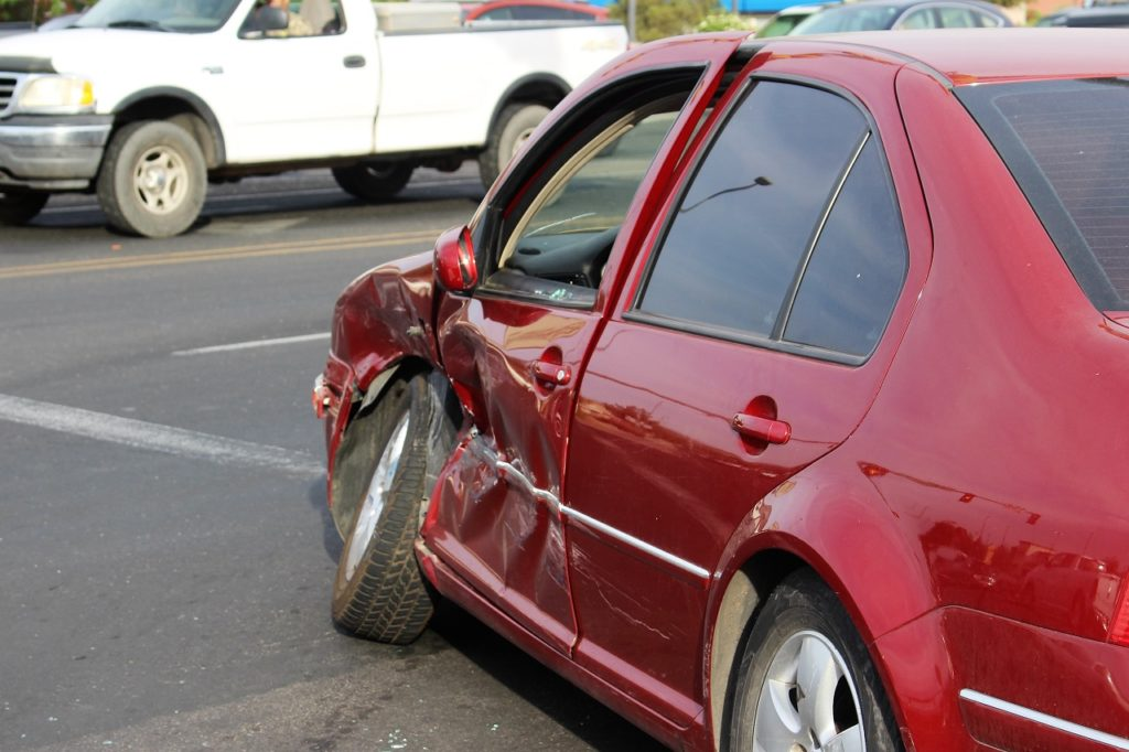A red Volkswagon Jetta sustained extensive driver's side damage after a two-car collision at the intersection of Green Springs Drive and Red Cliffs Drive, Washington City, Utah, June 10, 2016 | Photo by Cody Blowers, St. George News