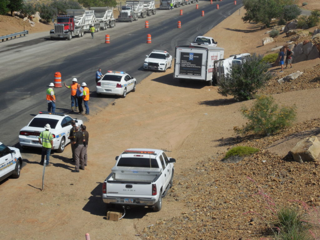A truck pulling a trailer rolls on S.R. 18 Wednesday morning, June 29, 2016 | Photo by Julie Applegate, St. George News