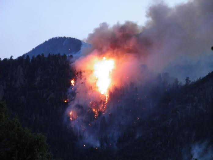 """""""The Forsyth Canyon portion of the Saddle Fire made a dramatic """"run"""" up the slope tonight shortly after sunset,"""" Washington County, Utah, June 28, 2016 