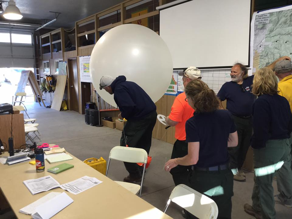Incident Meteorologist Jeff Colton and his team prepared a weather balloon for launch Monday. The balloon will measure temperature, relative humidity, wind speeds, wind direction and atmospheric pressure readings as it rises through the atmosphere, Washington County, Utah, June 27, 2016 | Photo courtesy of U.S. Forest Service, St. George News