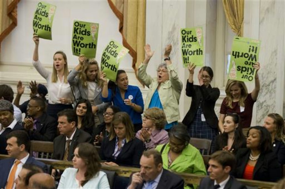 Audience members cheer after Philadelphia City Council passed a tax on sugary and diet beverages, in Philadelphia. Philadelphia has become the first major American city with a soda tax despite a multimillion-dollar campaign by the beverage industry to block it, Philadelphia, Pennsylvania, June 16, 2016 | AP Photo/Matt Rourke, File, St. George News