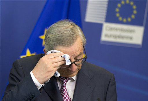European Commission President Jean-Claude Juncker wipes his brow before speaking during a media conference at EU headquarters in Brussels on Wednesday, June 22, 2016. Voters in the United Kingdom are taking part in a referendum on Thursday that will decide whether Britain remains part of the European Union or leaves the 28-nation bloc.   AP Photo/Virginia Mayo; St. George News
