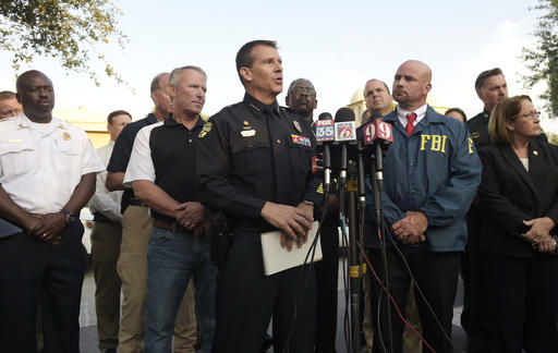 Orlando Police Chief John Mina, center, addresses reporters during a news conference after a shooting involving multiple fatalities at a nightclub Sunday in Orlando, Florida, June 12, 2016 | AP Photo/Phelan M. Ebenhack; St. George News