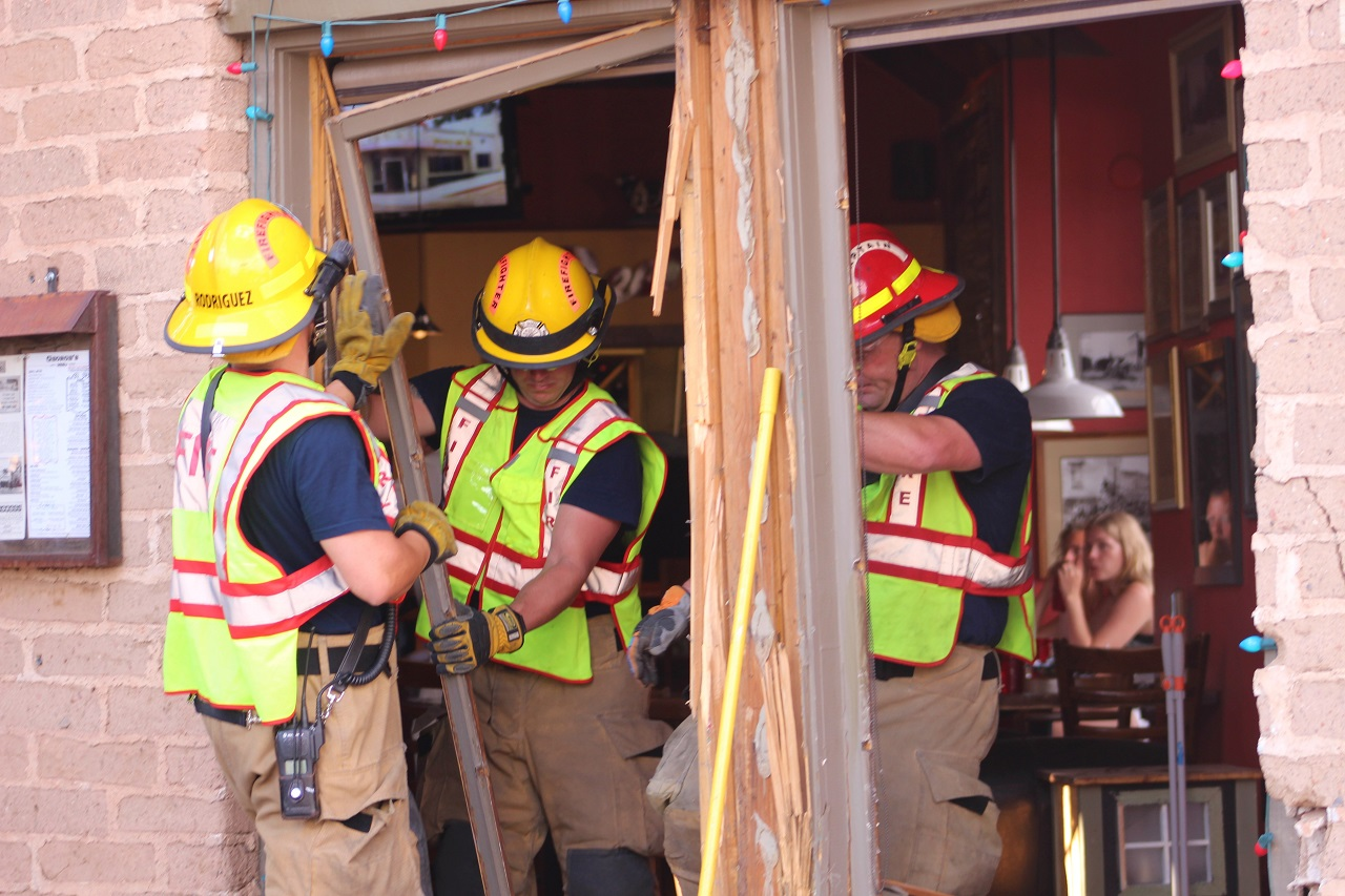 Firefighters removing debris and glass from George's Corner Restaurant where a vehicle entered the building following a three-car collision, St. George, Utah, June 29, 2016| Photo by Cody Blowers, St. George News