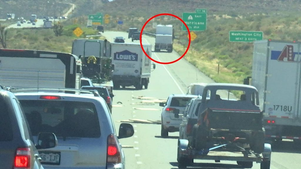 Flatbed semitrailer pulled over after realizing part of the load blew off trailer, shown here in the distance, Interstate 15 southbound lanes, Washington County, Utah, June 15, 2016 | Photo by Austin Peck, St. George News
