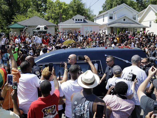 The hearse carrying the body of Muhammad Ali passes in front of his boyhood home, top center, during his funeral procession Friday in Louisville, Kentucky, June 10, 2016 | AP Photo/Mark Humphrey; St. George News