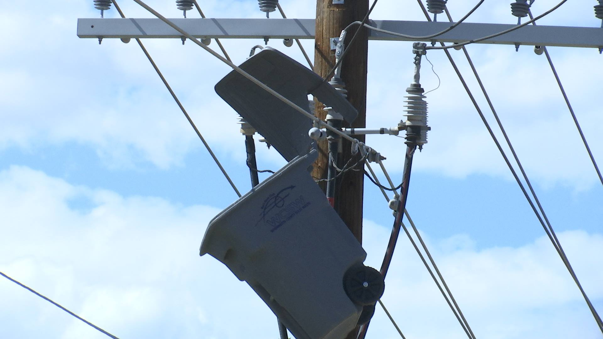 96 Gallon Trash Can Hangs In Power Lines After Heavy Winds St
