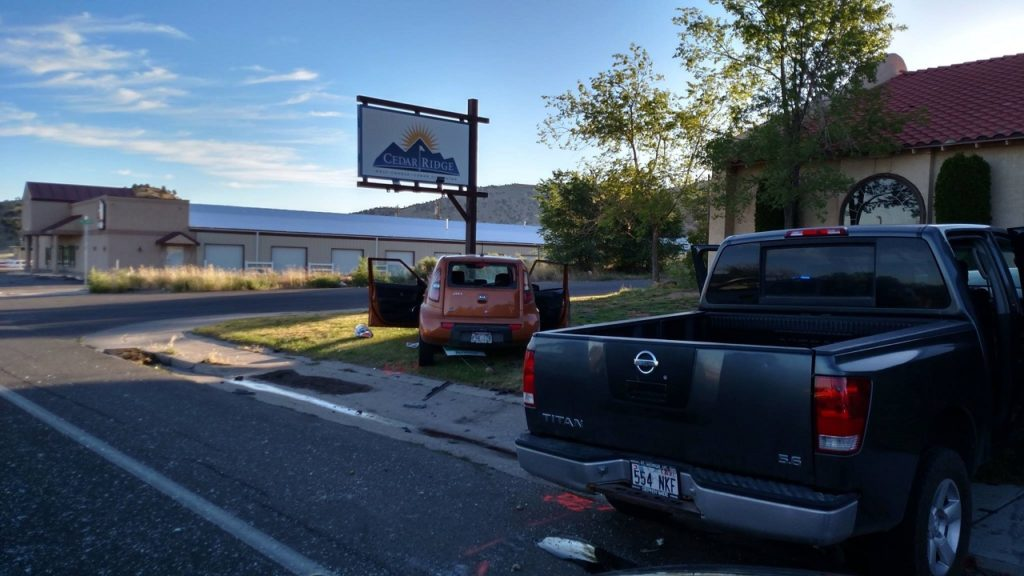 Gray Nissan Titan pickup truck and gold Kia Soul involved in fatal accident early Saturday morning, Cedar City, Utah, June 18, 2016 |Photo courtesy of Cedar City Police Department, St. George News