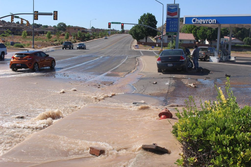 A car sheared off a fire hydrant, sending water onto South River Road Sunday morning. St. George, Utah, June 12, 2016 | Photo by Ric Wayman, St. George News
