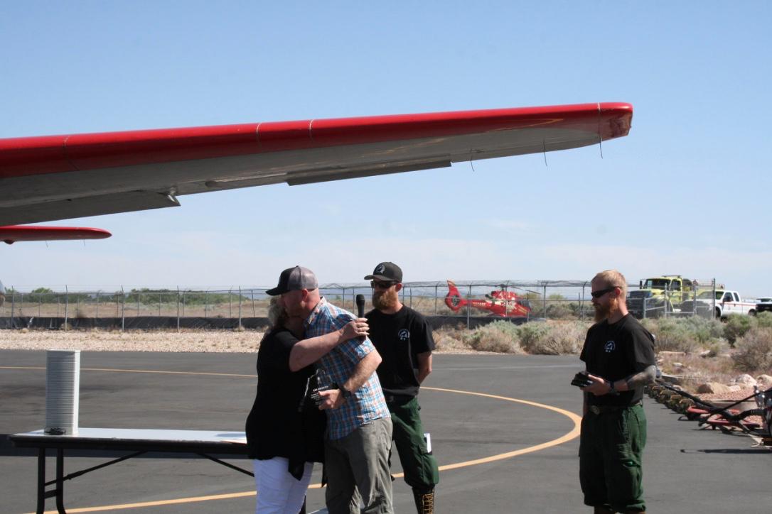 Vickie Miner of the Wildlife Firefighter Foundation presenting a remembrance token to Kris Bruington of the Lone Peak Hotshots, Cedar City, Utah, June 3, 2016   Photo by Kaleigh Bronson, St. George/Cedar City News