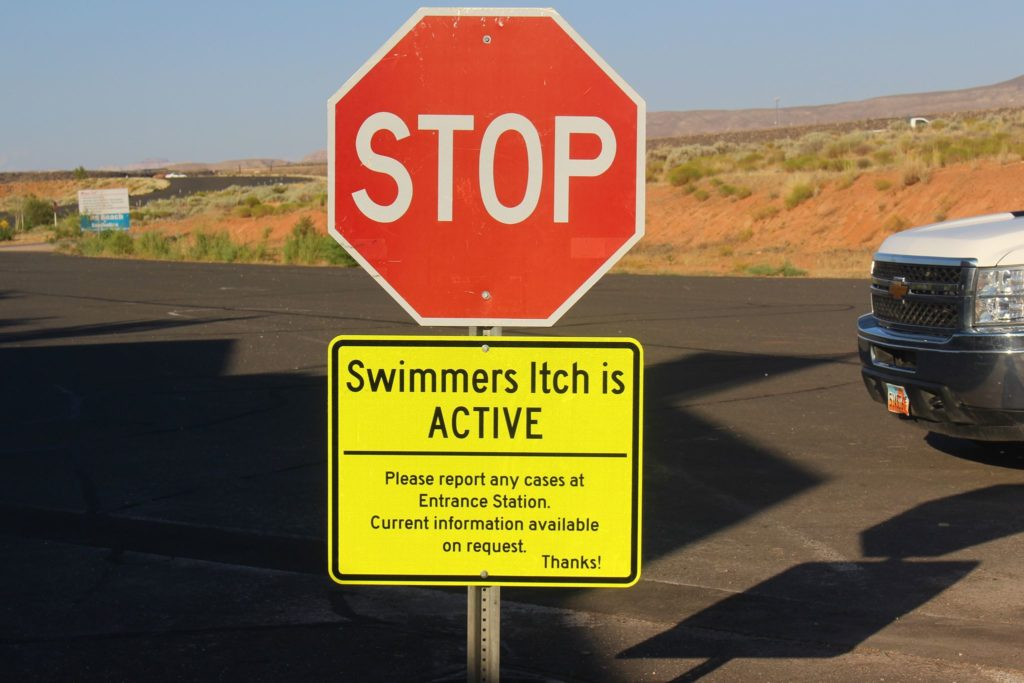 A sign at the entrance to Sand Hollow State Park warns visitors that swimmer's itch is active, Hurricane, Utah, June 23, 2016 | Photo by Cody Blowers, St. George News