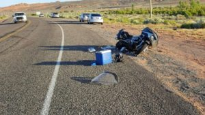 A motorcycle lays on the ground after a car made a U-turn in front of it Monday evening. Hurricane, Utah, June 6, 2016 | Photo courtesy of Sgt. Brandon Buell, St. George News