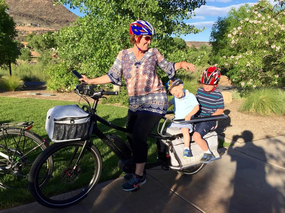Megan Rasmussen commuting on her cargo e-bike with her two children. St. George, Utah, May 2016 | Photo by Craig Shanklin, St. George News