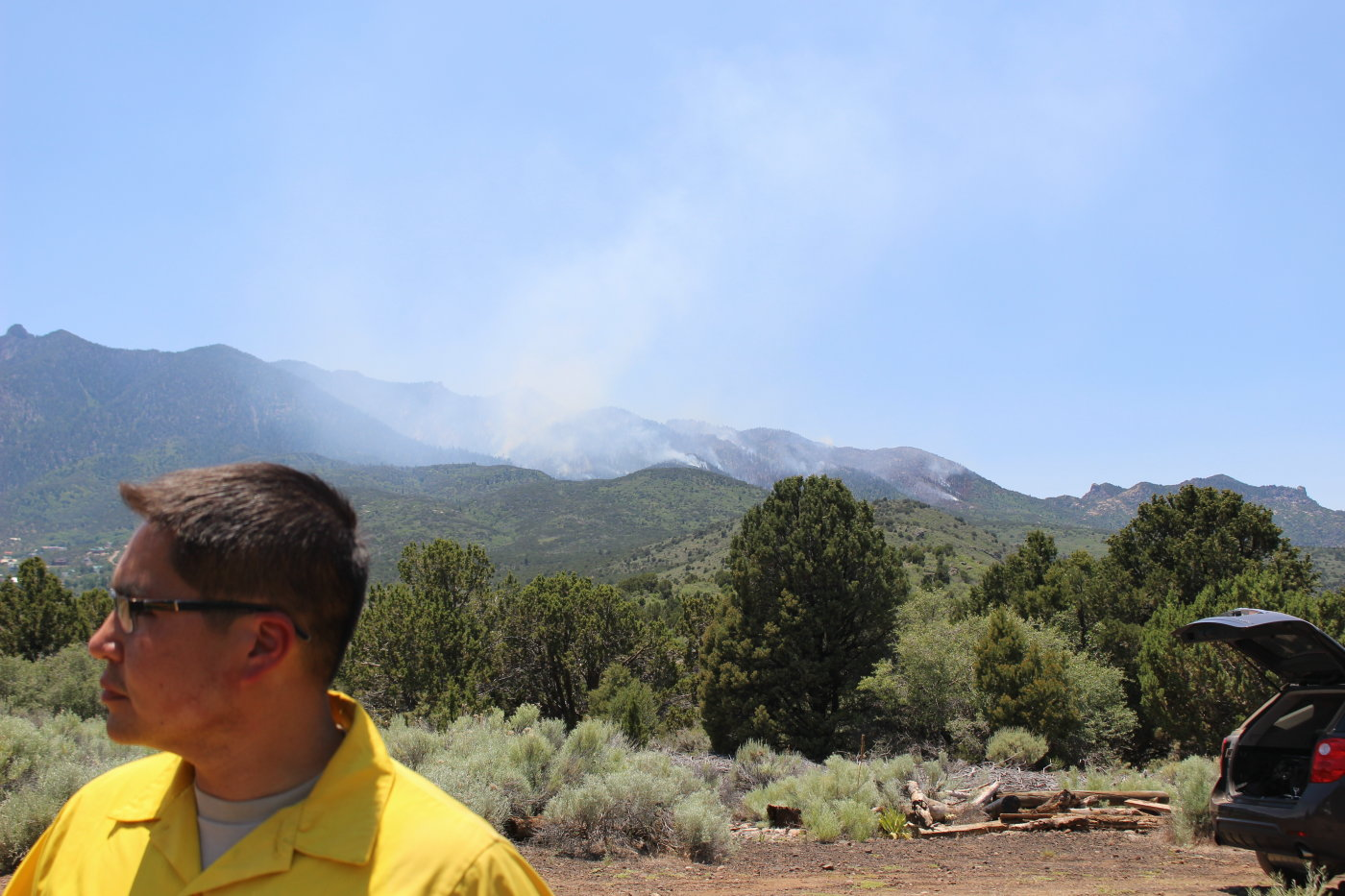 Smoke rises from the Saddle Fire in the background as Incident Commander Chris Henrie addressed members of the media, Pine Valley, Utah, June 20, June 20, 2016   Photo by Mori Kessler, St. George News