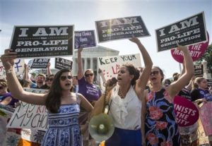 Reagan Barklage of St. Louis, center, and other anti-abortion activists demonstrate in front of the Supreme Court Monday as the justices struck down the strict Texas anti-abortion restriction law known as HB2. The justices voted 5-3 in favor of Texas clinics that had argued the regulations were a thinly veiled attempt to make it harder for women to get an abortion in the nation's second-most populous state. Washington, D.C. June 27, 2016 Photo by J. Scott Applewhite (AP), St. George News Summary