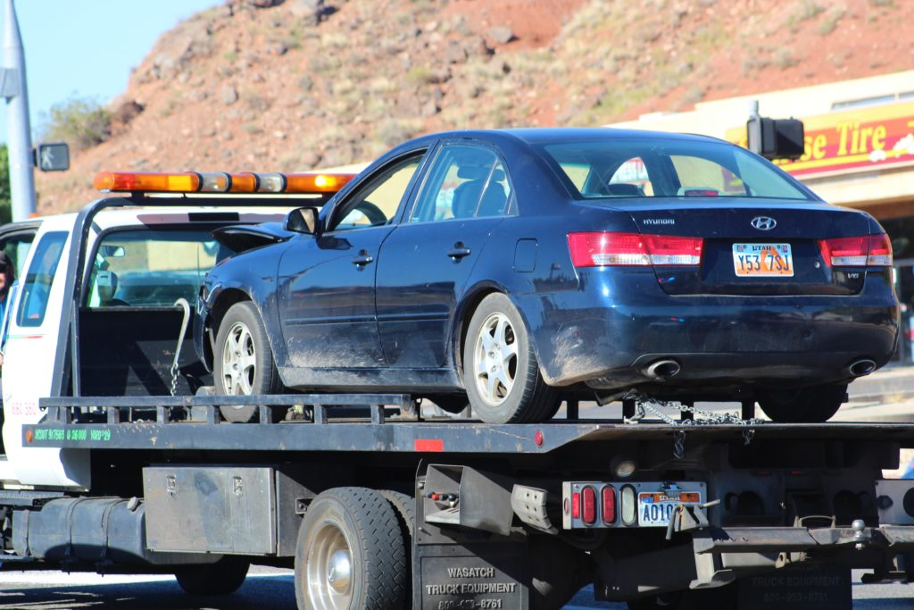 Dark blue Hyundai is towed after accident on Red Cliffs Drive, St. George, Utah, June 16, 2016 |Photo by Cody Blowers, St. George News