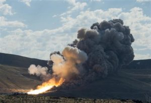 The second and final qualification motor (QM-2) test for the Space Launch System's booster is seen at Orbital ATK Propulsion Systems test facilities. During the Space Launch System flight the boosters will provide more than 75 percent of the thrust needed to escape the gravitational pull of the Earth, the first step on NASA's Journey to Mars. Promontory, Utah, June 28, 2016 | Photo by Bill Ingalls (NASA via AP), St. George News
