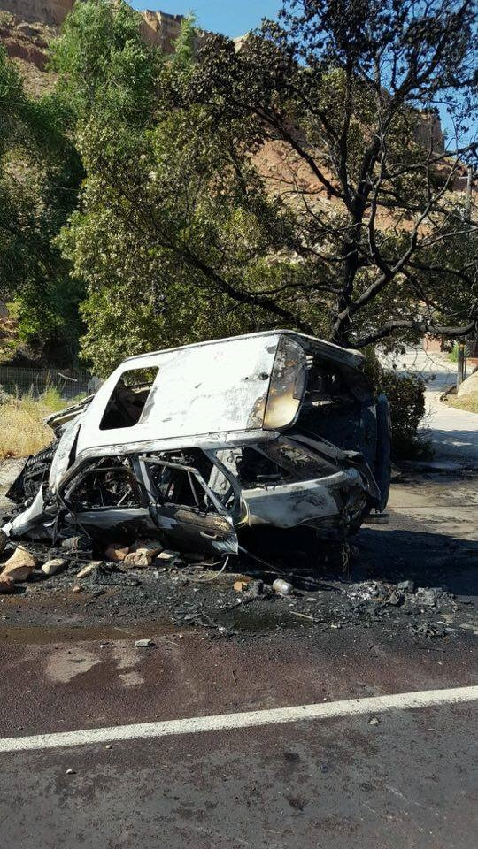 A white Land Rover is a charred mass after firefighters extinguish a blaze of a single-vehicle crash in Rockville, Utah, June 24, 2016 | Photo courtesy of Springdale/Zion Canyon Department of Public Safety Chief Garen Brecke, St. George News
