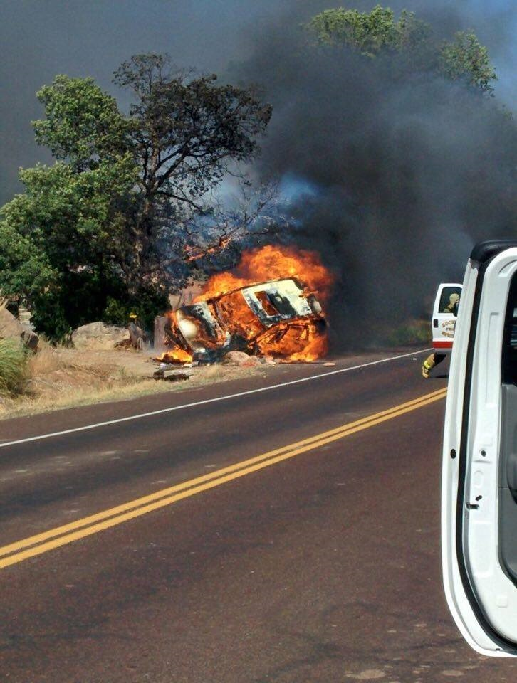 A white Land Rover burst into flames after rolling off West Main Street in Rockville Friday. Although the four occupants were injured, they all survived the crash. Rockville, Utah, June 24, 2016   Photo courtesy of Rockville/Springdale Fire Protection Chief Ryan Ballard, St. George News
