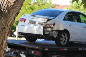 White Hyundai Sonata being towed after collision on 100 South at the intersection of Main Street in St. George, Utah, July 8, 2016 | Photo by Cody Blowers, St. George News
