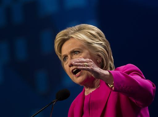 Democratic presidential candidate Hillary Clinton addresses the The National Education Association (NEA) Representative Assembly in Washington D.C., Tuesday, July 5, 2016. On Tuesday, FBI Director James Comey said the FBI will not recommend criminal charges in its investigation into Hillary Clinton's use of a private email server while secretary of state. AP Photo/Molly Riley, St. George News