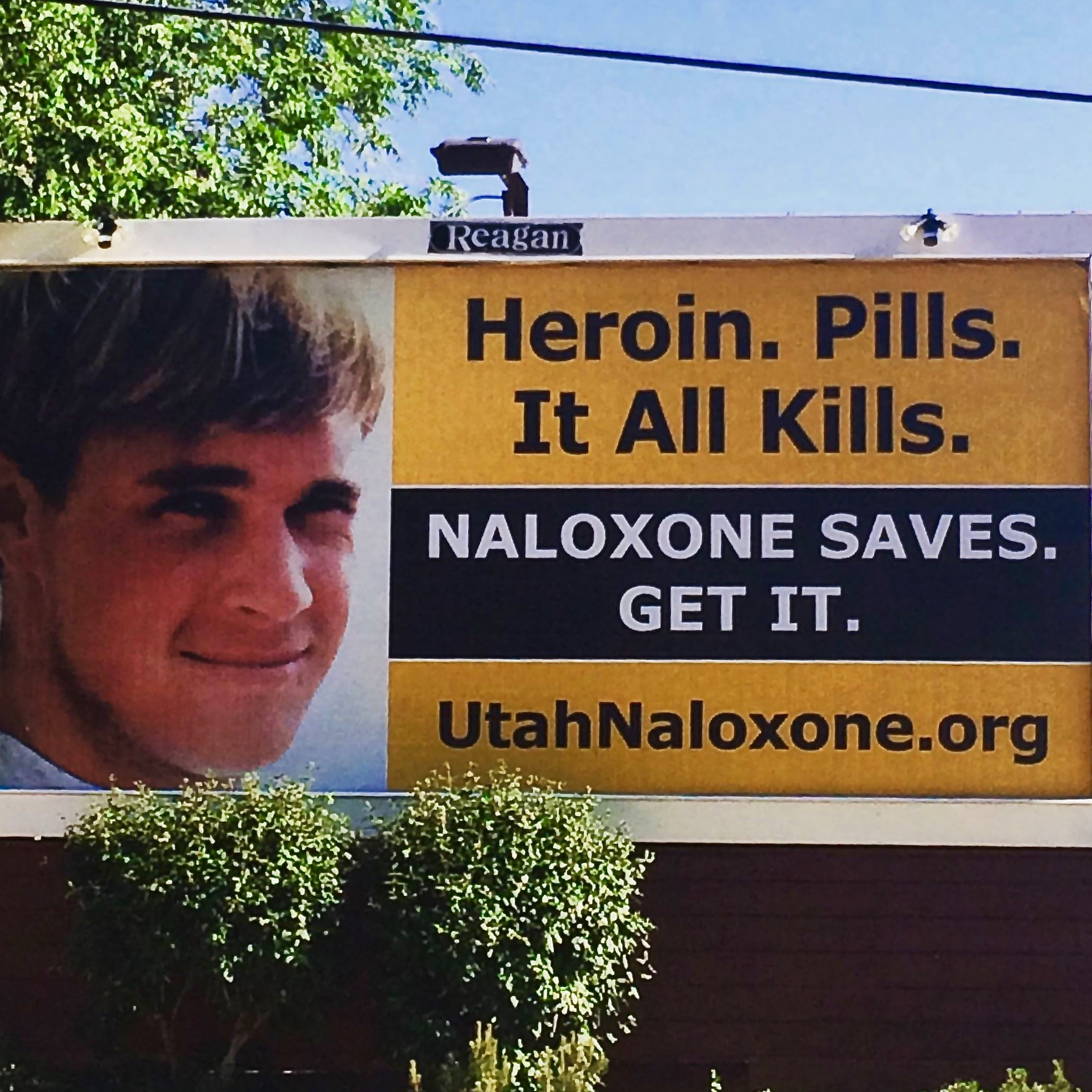 One of the billboards that has been placed in northern Utah showing a victim of a heroin overdose and promoting naloxone, an anti-overdose drug, Utah, circa June 2016 | Inset photo courtesy of Sam Plumb, Utah Naloxone; St. George News