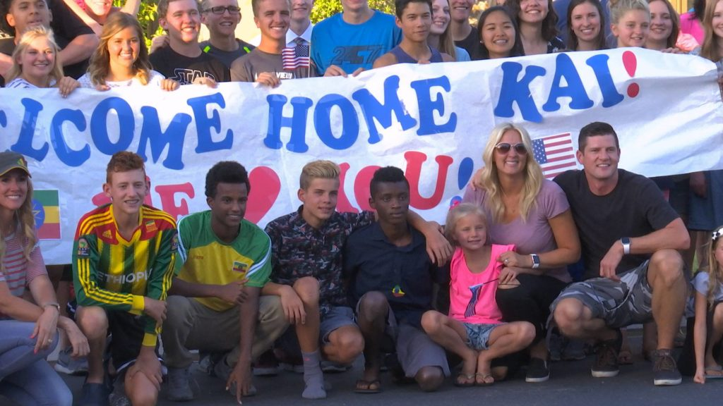 Neighbors and family gather at the Burke home to welcome Kai to America, Washington City, Utah, July 17, 2016 | Photo courtesy of Darci Burke, St. George News