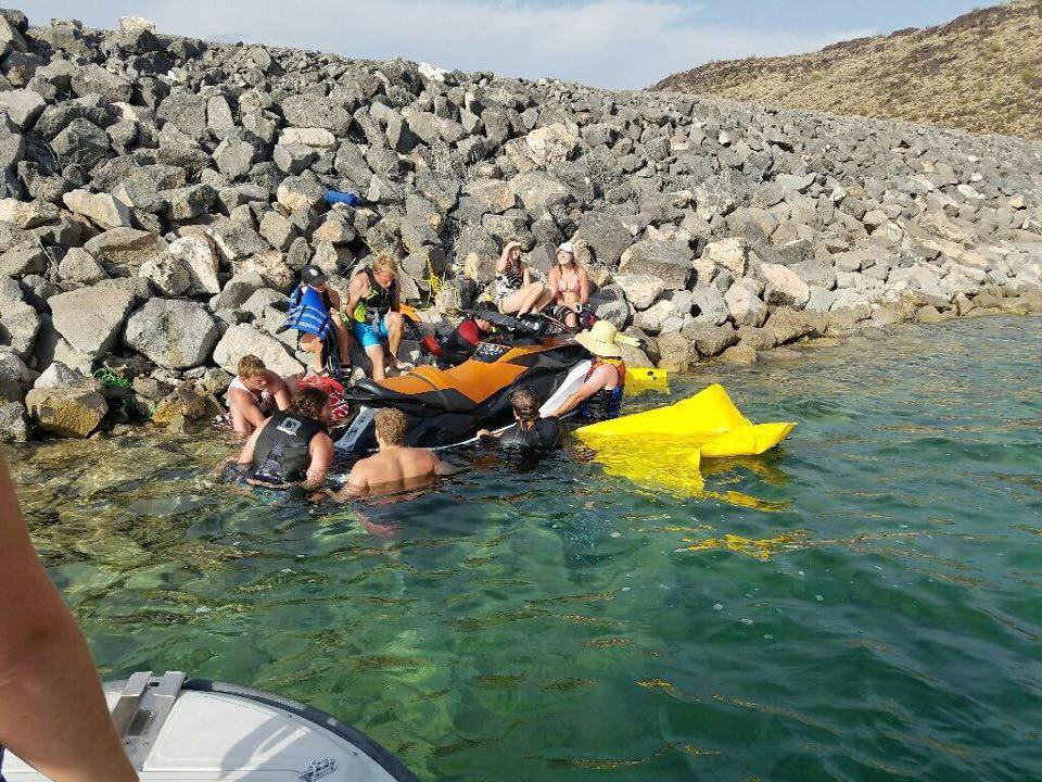 Search and Rescue Dive Team places lifting bags under sunken personal watercraft to bring it to the surface before towing it behind the Sand Hollow rescue boat, Sand Hollow State Park, Utah, July 30, 2016 | Photo courtesy of Darrell Cashin, St. George News