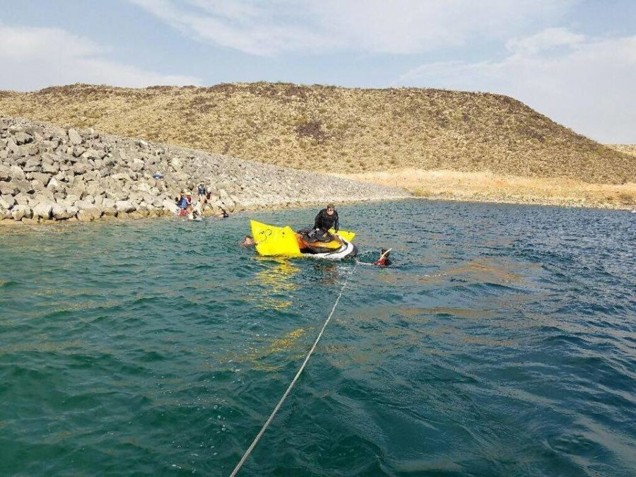 Search and Rescue Dive Team ties the watercraft behind the Sand Hollow rescue boat to bring it to shore, Sand Hollow State Park, Utah, July 30, 2016 | Photo courtesy of Darrell Cashin, St. George News
