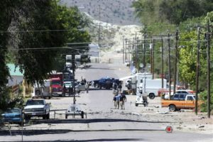 Police investigate shrapnel from a Wednesday night bombing that killed one person on 5th Street in Panaca, Nev., on Thursday, July 14, 2016 | Brett Le Blanc/Las Vegas Review-Journal via AP, St. George News