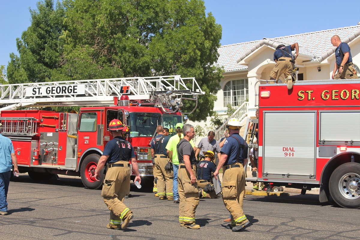Emergency personnel in front of residence where second story deck caught fire possibly from a barbecue, 100 block of 2000 East, St. George, Utah, July 27, 2016 | Photo by Cody Blowers, St. George News