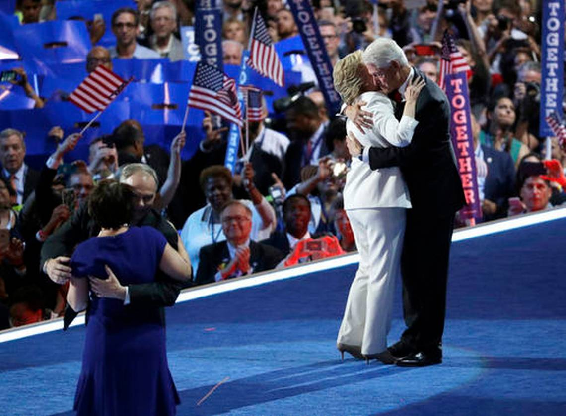 Former President Bill Clinton, right, hugs Democratic presidential nominee Hillary Clinton as Democratic vice presidential nominee Sen. Tim Kaine, D-Va., hugs his wife wife Anne Holton during the final day of the Democratic National Convention, Thursday, July 28, 2016, in Philadelphia | AP Photo by John Locher, St. George News