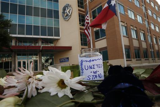 Flowers are left at Jack Evans Police Headquarters in Dallas, Texas, Friday, July 8, 2016 | Photo courtesy of Nathan Hunsinger/The Dallas Morning News via The Associated Press, St. George News