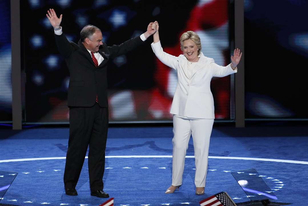 Democratic vice presidential nominee Sen. Tim Kaine, D-Va., and Democratic presidential nominee Hillary Clinton waves to delegates during the final day of the Democratic National Convention in Philadelphia , Thursday, July 28, 2016 | AP Photo by J. Scott Applewhite, St. George News