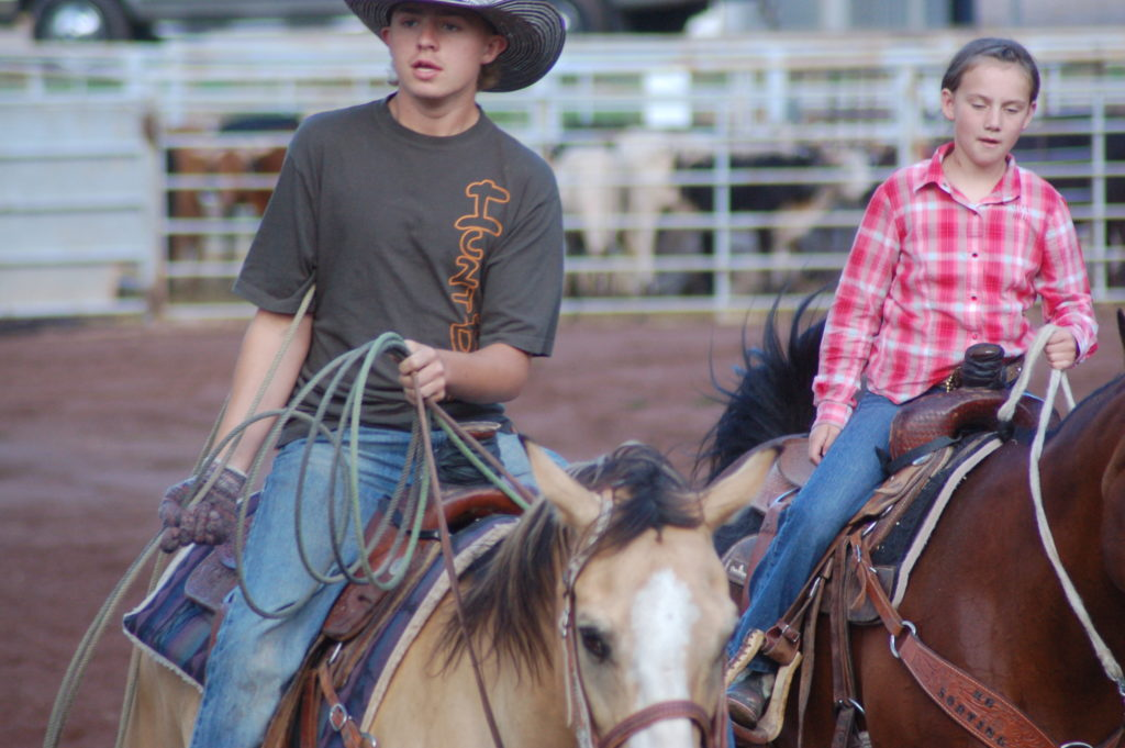 Young cowboys ride around the arena before the start of the Gunlock Rodeo, Gunlock, Utah, July 1, 2016 | Photo by Hollie Reina, St. George News