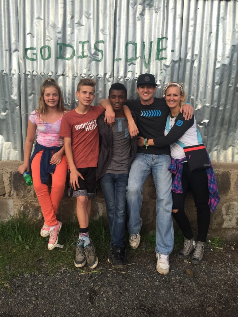 Brandon and Darci Burke (right) and their two oldest children (left) along visit Ethiopia and meet with Kai (middle), May, 2016 | Photo courtesy of Darci Burke, St. George News