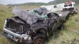 A male driver was transported to Beaver Hospital Saturday morning after he rolled his pickup truck and two trailers he was hauling, Beaver, Utah. July 2, 2016 | Photo courtesy of Utah Highway Patrol, St. George/Cedar City News
