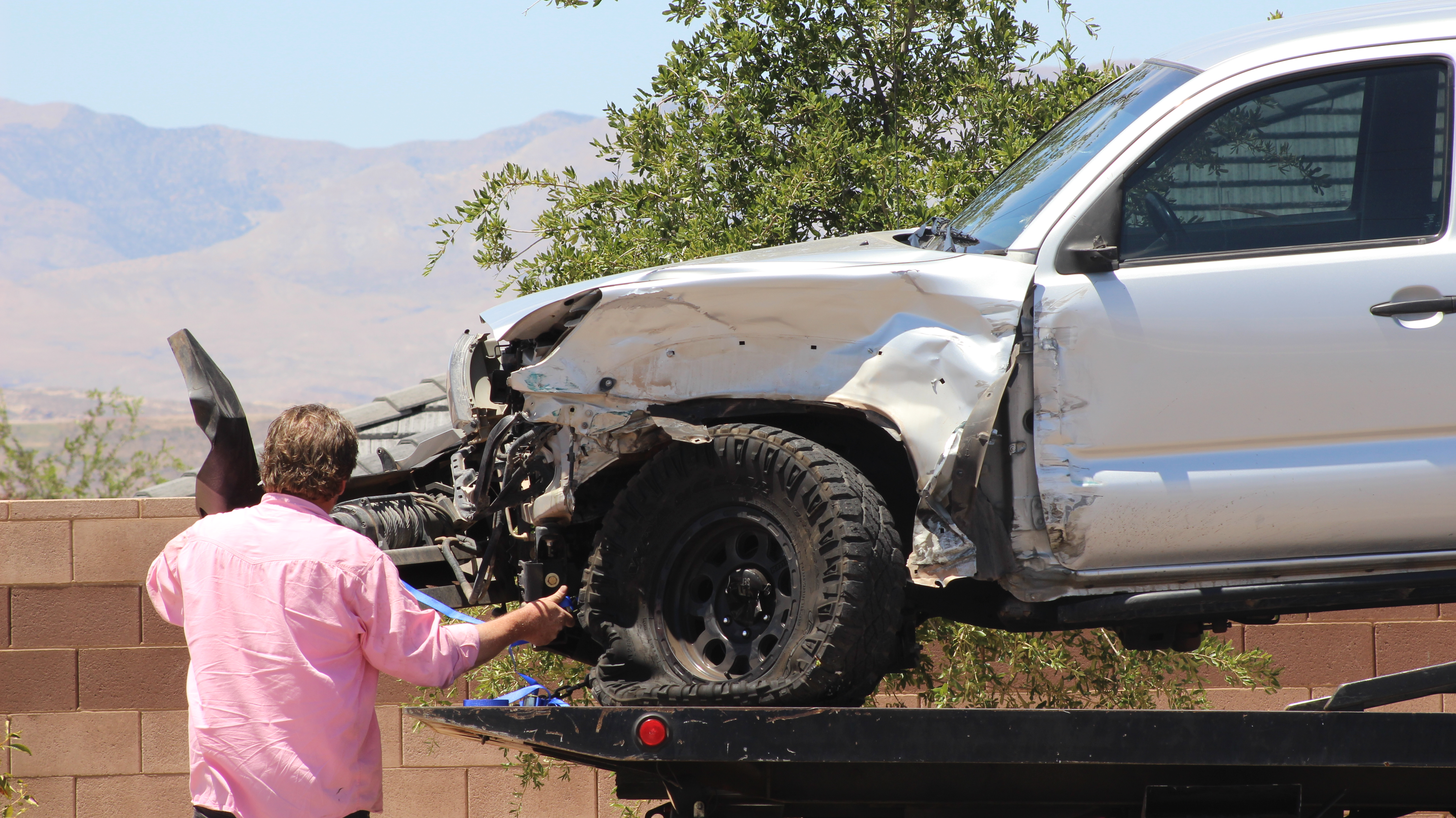 A collision between two trucks on 3000 E. left both vehicles badly damaged. The driver of the Toyota was cited for improper lane change, St. George, Utah, July 20, 2016 |Photo by Don Gilman, St George News
