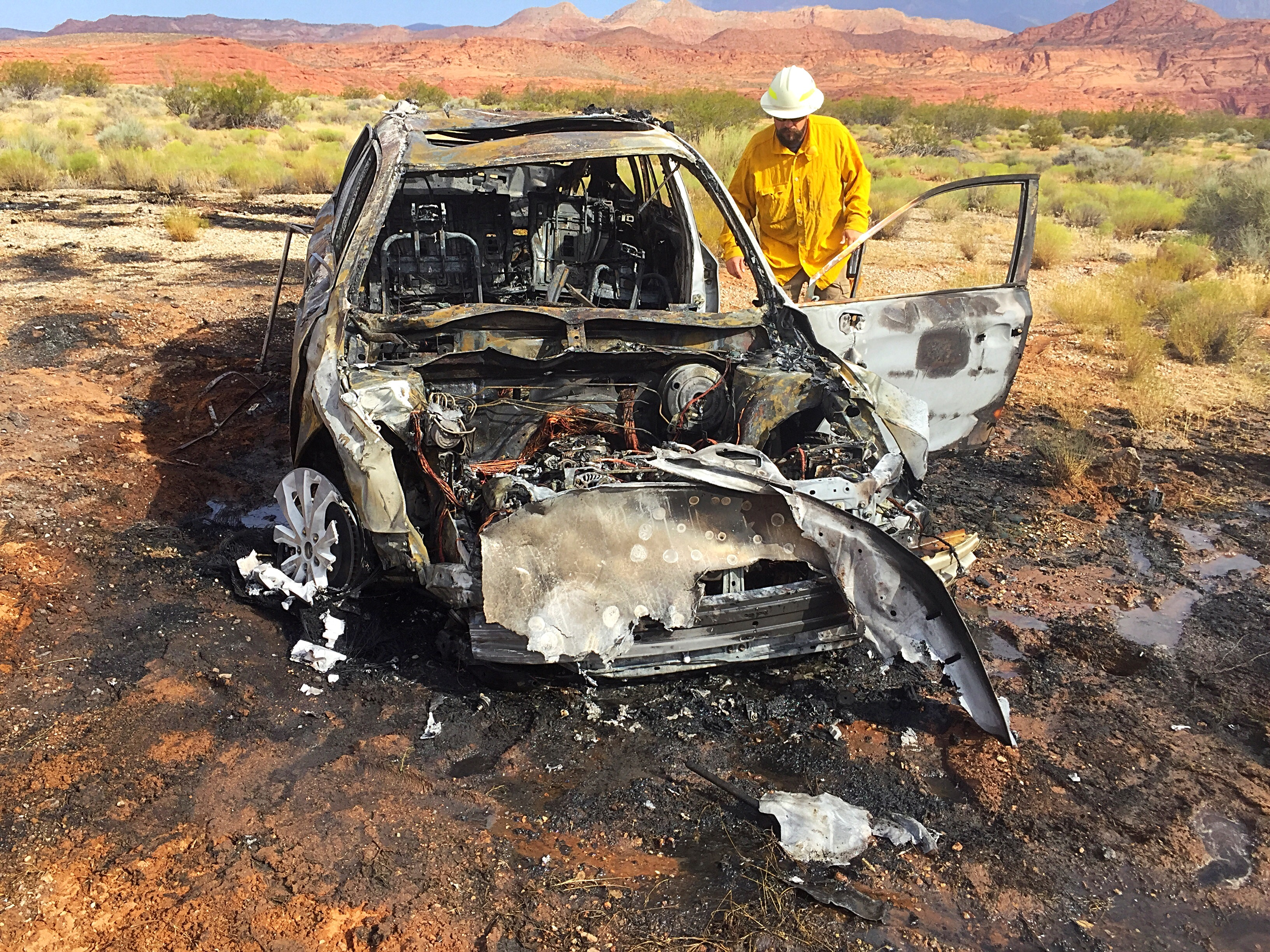 After being forced off the roadway by another vehicle, a Subaru Outback rolled before bursting into flames and igniting a brush fire in the median of Interstate 15 near milepost 19, Washington County, Utah, July 18, 2016 | Photo by Kimberly Scott, St. George News