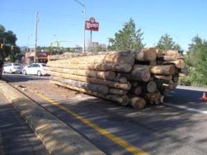 Log truck spills load blocking northbound on and off ramps, Exit 59 Interstate 15, Cedar City, Utah, July 15, 2016 | Photo courtesy of Utah Highway Patrol