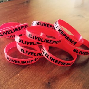 These wrist bands, bearing the hashtag #livelikepierce, have been sold as part of a fundraiser to help his family, date unspecified | photo courtesy of Amy Barney