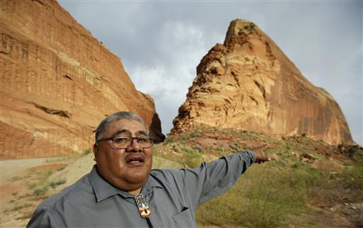 "Malcolm Lehi, a Ute Mountain Tribal Commissioner points to a rock formation near Blanding, Utah. ""We don't want to forget about our ancestors,"" said Lehi. ""Through them we speak. That's the whole concept of protecting and healing this land. They are still here among us as the wind blows."" Blanding, Utah, June 21, 2016 
