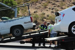 Both veicles loaded on tow trucks aftercollision on Bluff Street and 100 South, St. George, Utah, July 16, 2016 | Photo by Cody Blowers, St. George News