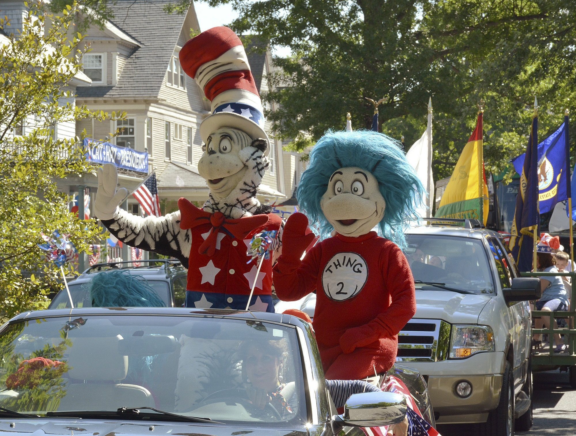 "A character portraying the Cat in the Hat parades with Thing 2, Tuesday, July 26, 2016, after he declared he is running for President with running mates Thing 1 and Thing 2, outside the childhood home of their creator Theodor Geisel, better known as Dr. Seuss, on Fairfield Street in Springfield, Mass. The event served as the official launch for the new Random House book ""One Vote, Two Votes, I Vote, You Vote."" Photo by Dave Roback/The Republican via AP; St. George News"