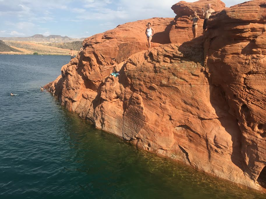 Visitors to Sand Hollow Reservoir take turns jumping cliffs, Hurricane, Utah, June 22, 2016 | Photo by Sheldon Demke, St. George News