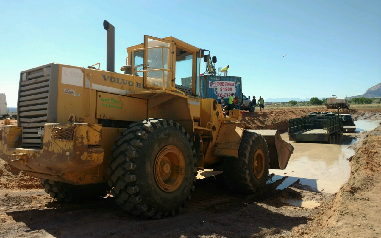 A tractor was pulling a truck from the mud when a cable snapped and injured a 10-year-old girl at a Mud Bogging event held at 590 Mohave Avenue, Colorado City, Arizona, July 23, 2016 | Photo courtesy of Joan Dineen, St. George News