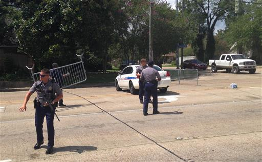 Baton Rouge police officers man a roadblock at Old Hammond Highway and Tara Boulevard after multiple officers were shot, Sunday. Baton Rouge, Louisiana,  July 17, 2016| AP Photo/Mike Kunzelman; St. George News