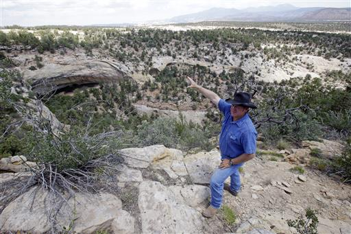 "Rancher Kenny Black points to a rock overhang housing an ancient cliff dwelling, near Blanding, Utah. ""These areas are sacred to me because I've grown up here,"" said Black, who comes from Mormon pioneers who came to the area in the late 19th Century. ""They're part of my history and my culture as well."" Blanding, Utah, June 23, 2016 