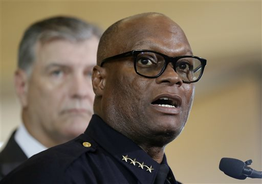 Dallas Police Chief David Brown, front, and Dallas mayor Mike Rawlings, rear, talk with the media during a news conference, Dallas, Texas, Friday, July 8 | Associated Press photo by Eric Gay, St. George News